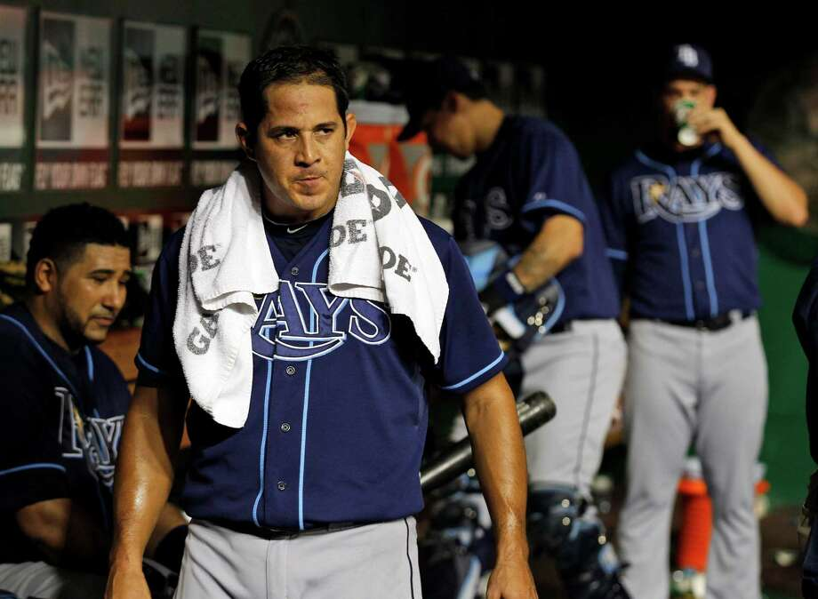 Tampa Bay Rays relliever Joel Peralta walks in the dugout after pitching during the eighth inning of a baseball game with the Washington Nationals, Wednesday, June 20, 2012, in Washington. The Nationals won 3-2. Photo: AP