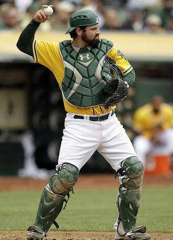 Oakland Athletics catcher Derek Norris throws the ball back to pitcher Travis Blackley during the fourth inning of a baseball game against the Los Angeles Dodgers, Thursday, June 21, 2012, in Oakland, Calif. Norris was recalled from Triple-A Sacramento on Thursday in time to start the series finale against the Dodgers. (AP Photo/Ben Margot) Photo: Ben Margot, Associated Press