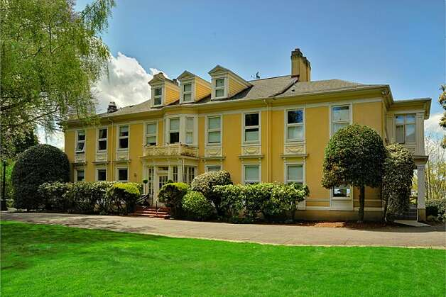 Here's a 1910 Capitol Hill mansion that's positively palatial. The 9,020-square-foot house, 1117 Boylston Ave E., has six bedrooms and 6.5 bathrooms, including a master bedroom with a fireplace and a nanny's quarters, a wood-paneled library with a fireplace and a sunroom with French doors leading to a huge deck looking down on Lake Union. The property is about an acre, with a fountain, gazebo, tennis court and three-car garage. It's listed for $3.199 million. Don't miss the funky video at the end of this slideshow. Photo: Jason Mercio/Mercio Photography,  Courtesy Nancy Williams/Windermere Real Estate