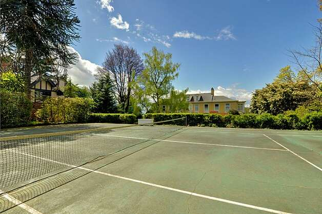 Tennis court of 1117 Boylston Ave E. The 9,020-square-foot house, built in 1910, has six bedrooms and 6.5 bathrooms, including a master bedroom with a fireplace and a nanny's quarters, a wood-paneled library with a fireplace and a sunroom with French doors leading to a huge deck looking down on Lake Union. The property is about an acre, with a fountain, gazebo and three-car garage. It's listed for $3.199 million. Photo: Jason Mercio/Mercio Photography, Courtesy Nancy Williams/Windermere Real Estate