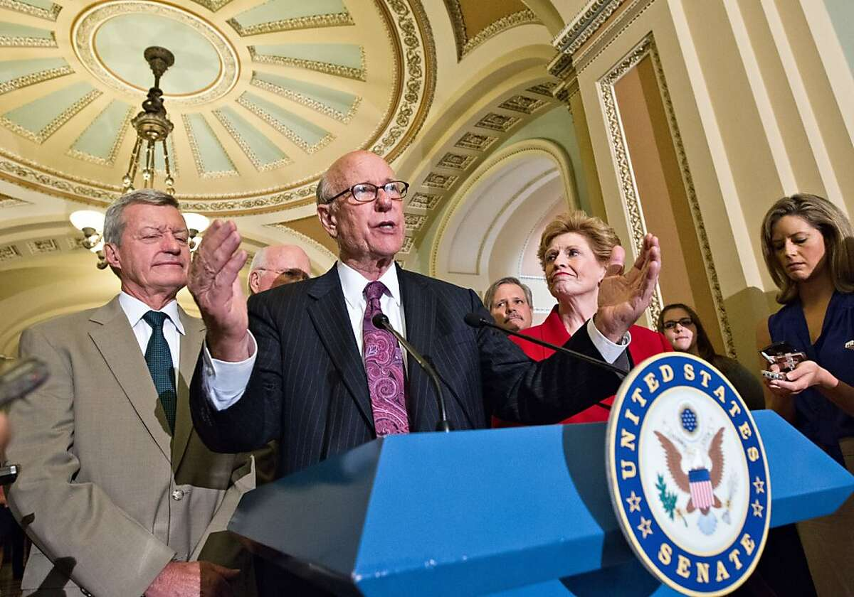 Members of the Senate Agriculture, Nutrition and Forestry Committee praise the bipartisan passage of the Farm Bill, at the Capitol in Washington, Thursday, June 21, 2012. From left are Sen. Max Baucus, D-Mont., Sen. Pat Roberts, R-Kan., speaking, Sen. John Hoeven, R-ND, rear, and Sen. Debbie Stabenow, D-Mich., chairman. (AP Photo/J. Scott Applewhite)