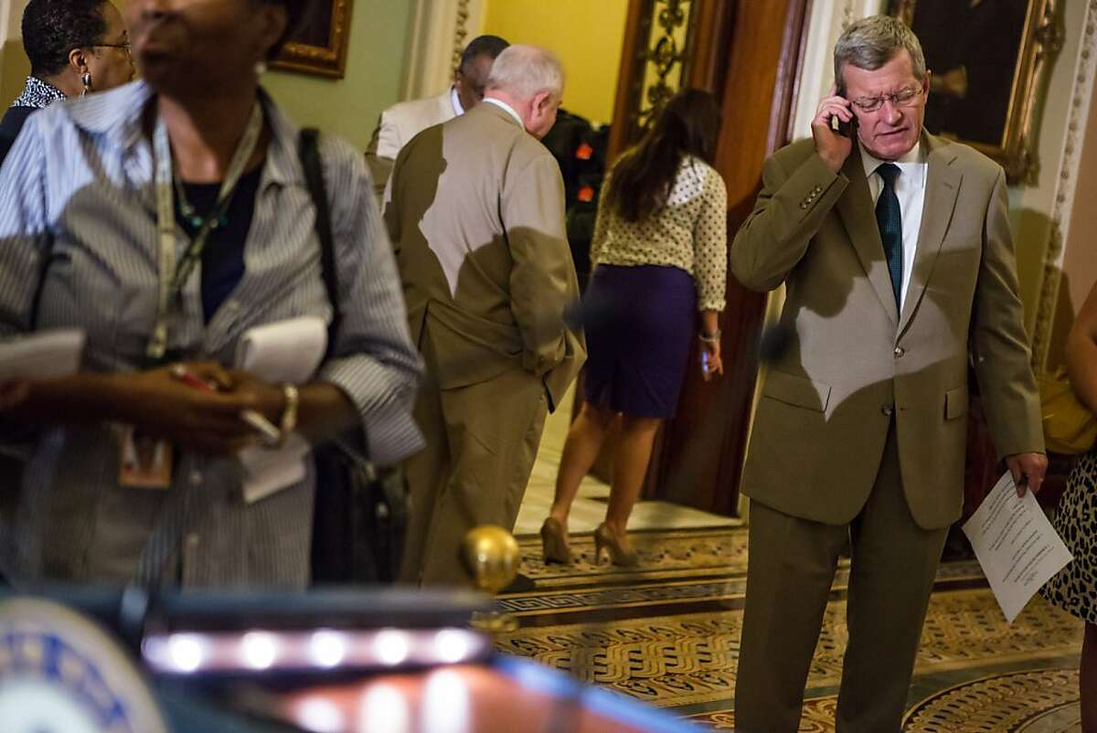 WASHINGTON - JUNE 21: Sen. Max Baucus (D-MT) talks on the phone before a news conferece on Capitol Hill on June 21, 2012 in Washington, DC. The Senate passed its version of the farm bill, which will now have to be merged with a House version before final passage. (Photo by Brendan Hoffman/Getty Images)