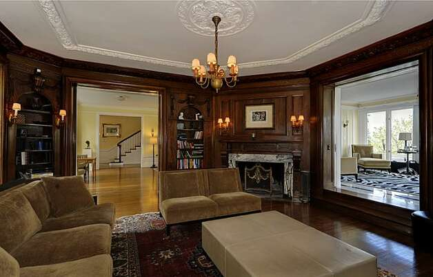 Library of 1117 Boylston Ave E. The 9,020-square-foot house, built in 1910, has six bedrooms and 6.5 bathrooms, including a master bedroom with a fireplace and a nanny's quarters and a sunroom with French doors leading to a huge deck looking down on Lake Union. The property is about an acre, with a fountain, gazebo, tennis court and three-car garage. It's listed for $3.199 million. Photo: Jason Mercio/Mercio Photography, Courtesy Nancy Williams/Windermere Real Estate