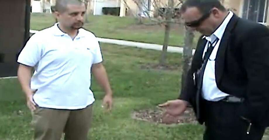 In this Feb. 27, 2012 image taken from a Sanford Police video posted on a website called gzlegalcase.com by George Zimmerman's defense team, Zimmerman speaks to an unidentifed investigator at the scene of Trayvon Martin's fatal shooting a day later giving police a blow-by-blow account of his fight with the teen.  On the tape, Zimmerman did a reenactment of the scuffle with Martin in the moments before he shot the 17-year-old from Miami. (AP Photo/Sanford Police video via Zimmerman Defense Team) Photo: Associated Press