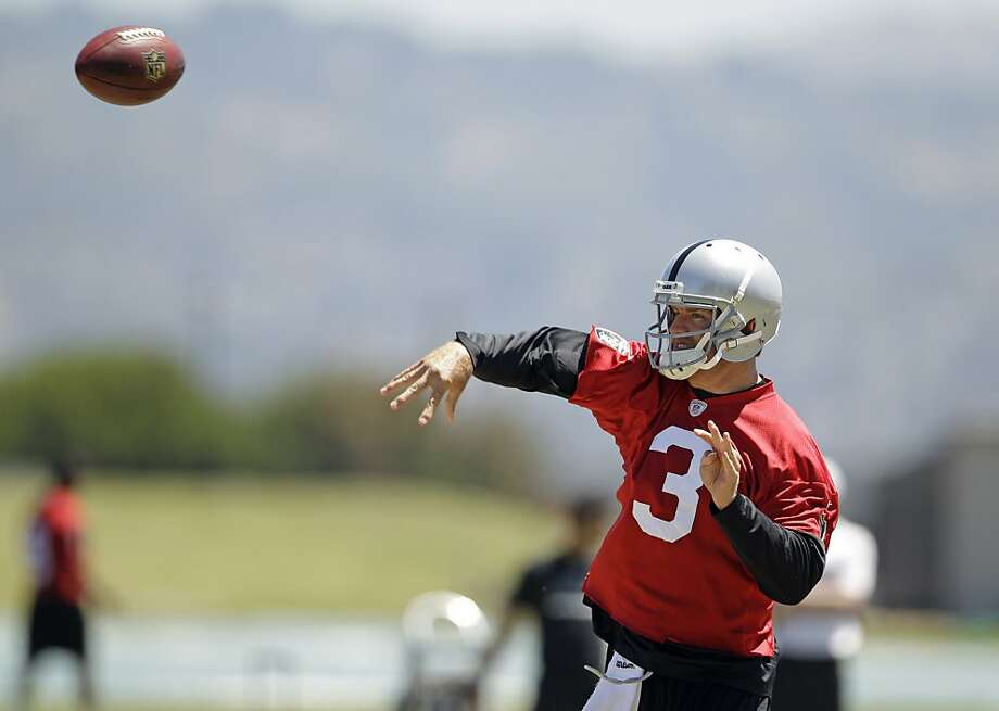 Oakland Raiders quarterback Carson Palmer throws during NFL football practice in Alameda, Calif., Wednesday, June 13, 2012. (AP Photo/Marcio Jose Sanchez) Photo: Marcio Jose Sanchez, Associated Press