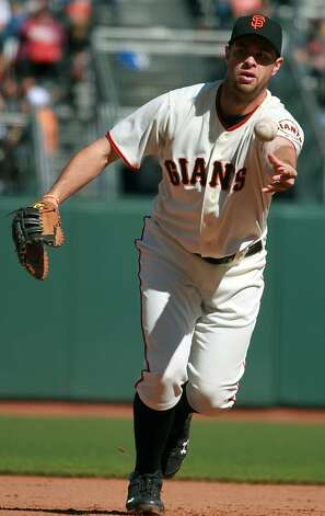 San Francisco Giants first baseman Brandon Belt fields a hit by Oakland Athletics Brandon Moss in the ninth inning of their final spring training baseball game, in San Francisco Calif., on Wednesday, April 4, 2012. The A's won 8-1. Photo: Lance Iversen, The Chronicle