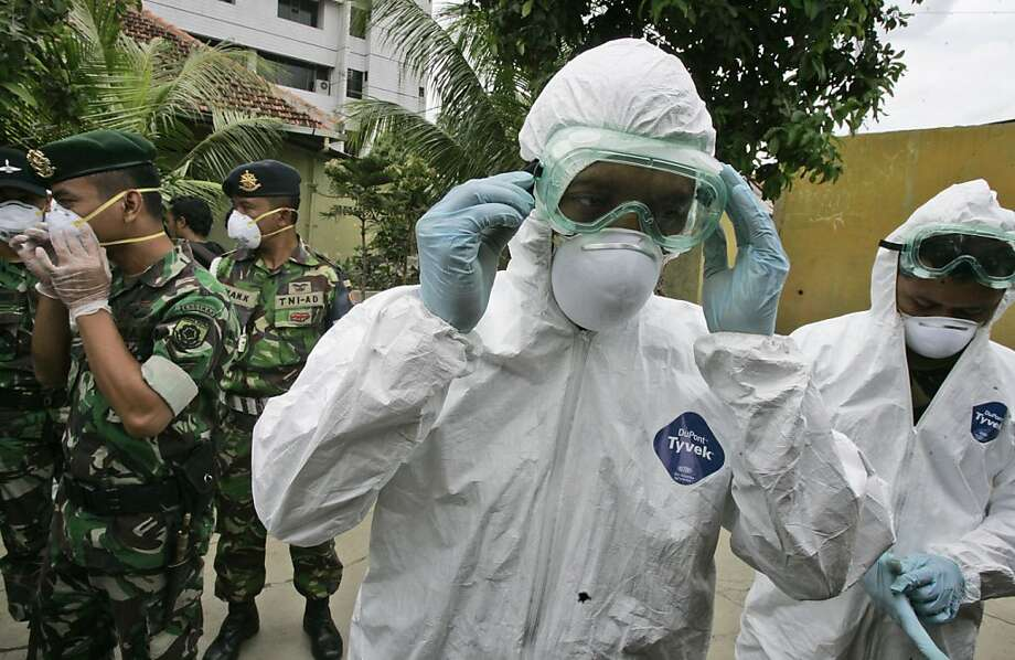 FILE - In this Tuesday, Dec. 16, 2008 file photo, soldiers wear protective gear during a bird flu prevention drill in Jakarta, Indonesia. The second of two bird flu studies once considered too risky to publish was released Thursday, June 21, 2012 ending a saga that pitted concerns about terrorism against fears of a deadly global epidemic. Both papers describe how researchers created virus strains that could potentially be transmitted through the air from person to person. Scientists said the results could help them spot dangerous virus strains in nature. (AP Photo/Irwin Fedriansyah) Photo: Irwin Fedriansyah, Associated Press