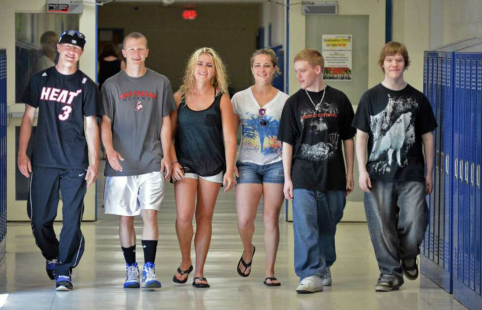 Seniors and twins, from left, Cody and Shane Marshall, Lindsay and Emily Martin and Jordan and Justin Crandall at Galway High School on Wednesday June 20, 2012. (John Carl D'Annibale / Times Union)