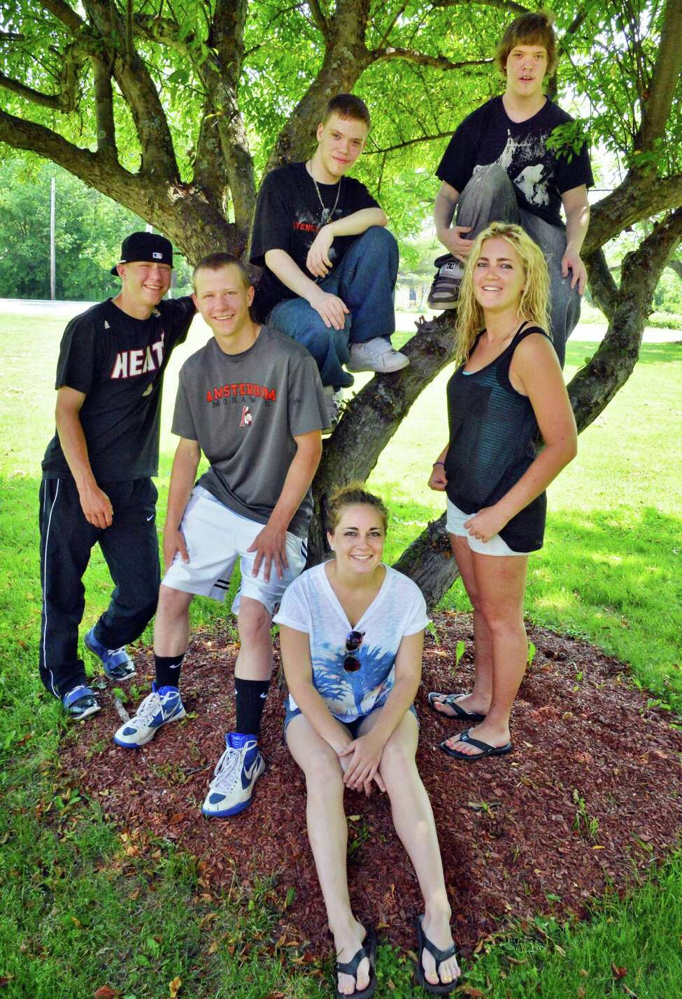 Seniors and twins Cody and Shane Marshall, left, Jordan and Justin Crandall, and Emily and Lindsay Martin outside Galway High School on Wednesday, June 20, 2012. (John Carl D'Annibale / Times Union)