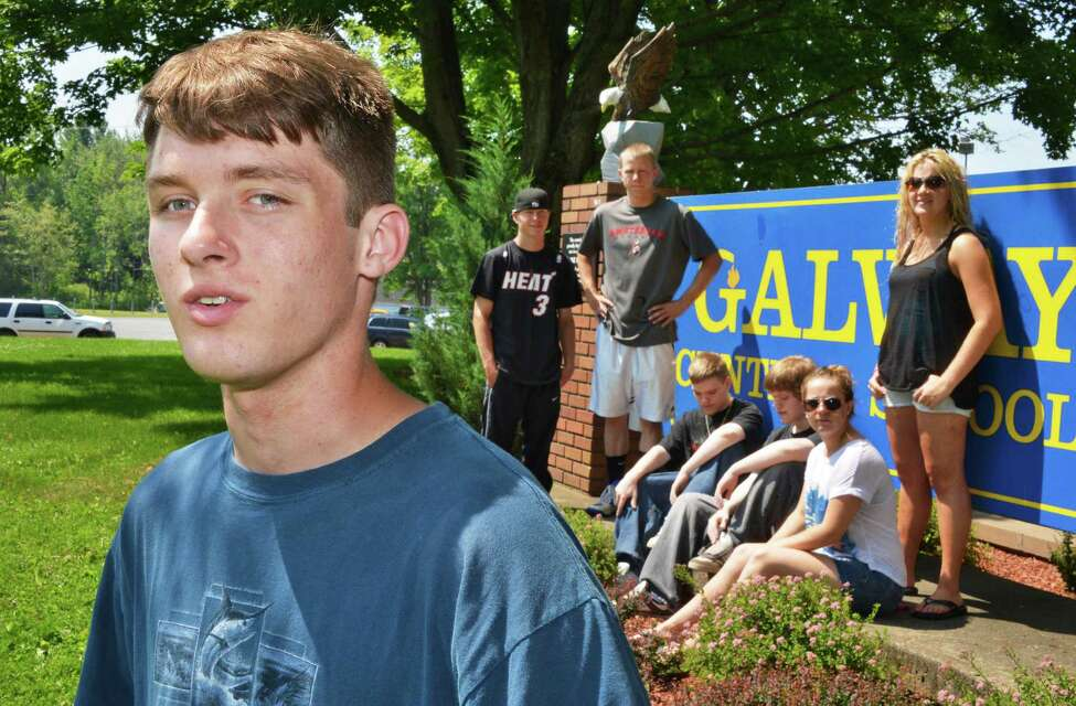 A high school senior and a twin, Nathan Peters, left, foreground, with some of Galway High School's other sets of twins, background, outside the school on Wednesday, June 20, 2012. (John Carl D'Annibale / Times Union)