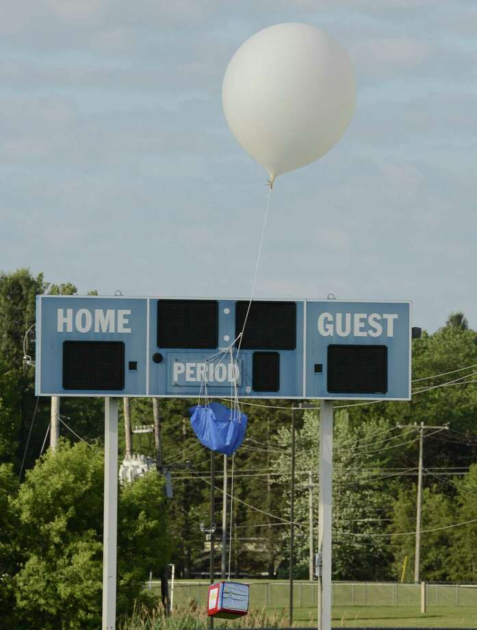 A helium balloon carrying a Shaker Hi student experiment  on an ill-fated mission in a field near Shakier High School in Latham, N.Y. June 14, 2012. The balloon never gained enough altitude to get past the scoreboard on the south end of the field.  (Skip Dickstein/Times Union) Photo: Matthew Hamilton / 00018067A