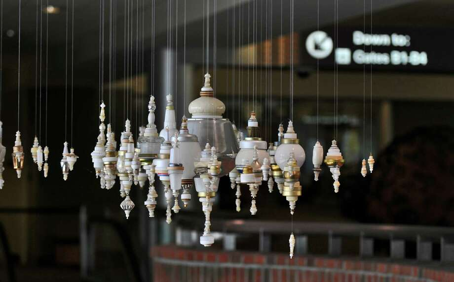 "The Albany International Airport will host next week's meeting of the American Association of Airport Executives (AAAE) Arts in the Airport Workshop. Kirsten Hassenfeld's ""Treen Three"" is on display at the airport's passenger terminal on Wednesday June 20, 2012 in Colonie, NY. (Philip Kamrass / Times Union) Photo: Philip Kamrass / 00018172A"
