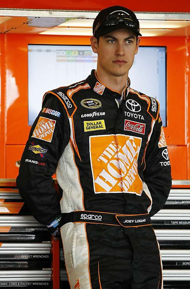 LONG POND, PA - JUNE 06:  Joey Logano, driver of the #20 Home Depot Toyota stands in the garage during NASCAR testing for the new track surface at Pocono Raceway on June 6, 2012 in Long Pond, Pennsylvania.  (Photo by Jeff Zelevansky/Getty Images for NASCAR) Photo: Jeff Zelevansky, Getty Images For NASCAR