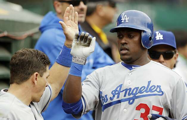 Los Angeles Dodgers' Elian Herrera, right, is congratulated after scoring against the Oakland Athletics during the fourth inning of a baseball game, Thursday, June 21, 2012, in Oakland, Calif. Herrera scored on a single by Juan Rivera. (AP Photo/Ben Margot) Photo: Ben Margot, Associated Press