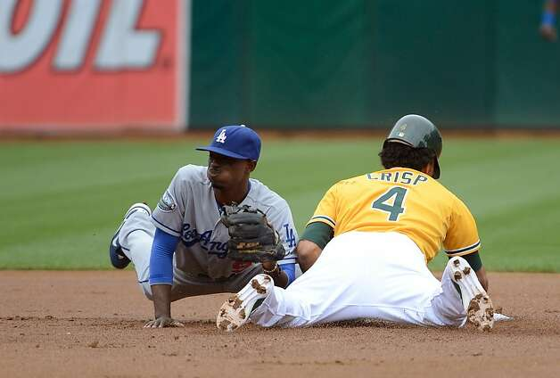 OAKLAND, CA - JUNE 21:  Coco Crisp #4 of the Oakland Athletics gets caught stealing in the first inning tagged out by Dee Gordon #9 of the Los Angeles Dodgers at O.co Coliseum on June 21, 2012 in Oakland, California.  (Photo by Thearon W. Henderson/Getty Images) Photo: Thearon W. Henderson, Getty Images