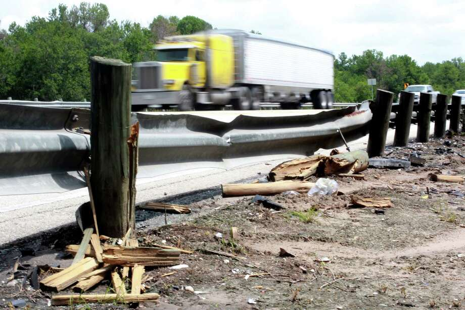 A guardrail along the 2500 block of Eldridge Parkway displays damage sustained during Wednesday's three-vehicle crash. The accident on the rain-slickened road resulted in three deaths. Photo: Johnny Hanson / © 2012  Houston Chronicle