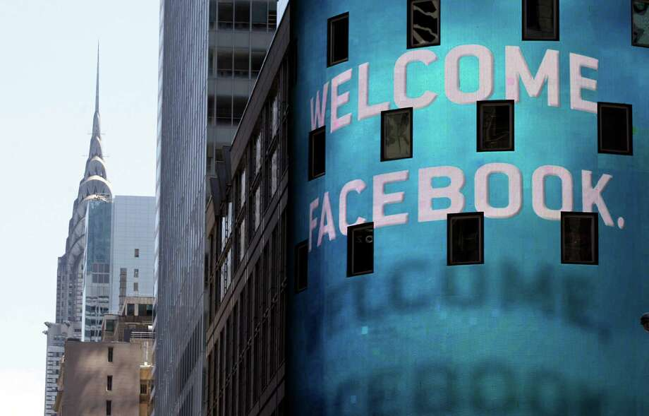 FILE- In this Friday, May 18, 2012, file photo, the animated facade of the Nasdaq MarketSite, welcomes the Facebook IPO, in New York's Times Square. It's been a month since Facebook's IPO fell flat and in that time, the market for initial public offerings has gone cold. Venture capitalists say the fallout from Facebook's rocky IPO is making technology companies more cautious about going public. (AP Photo/Richard Drew, File) Photo: Richard Drew