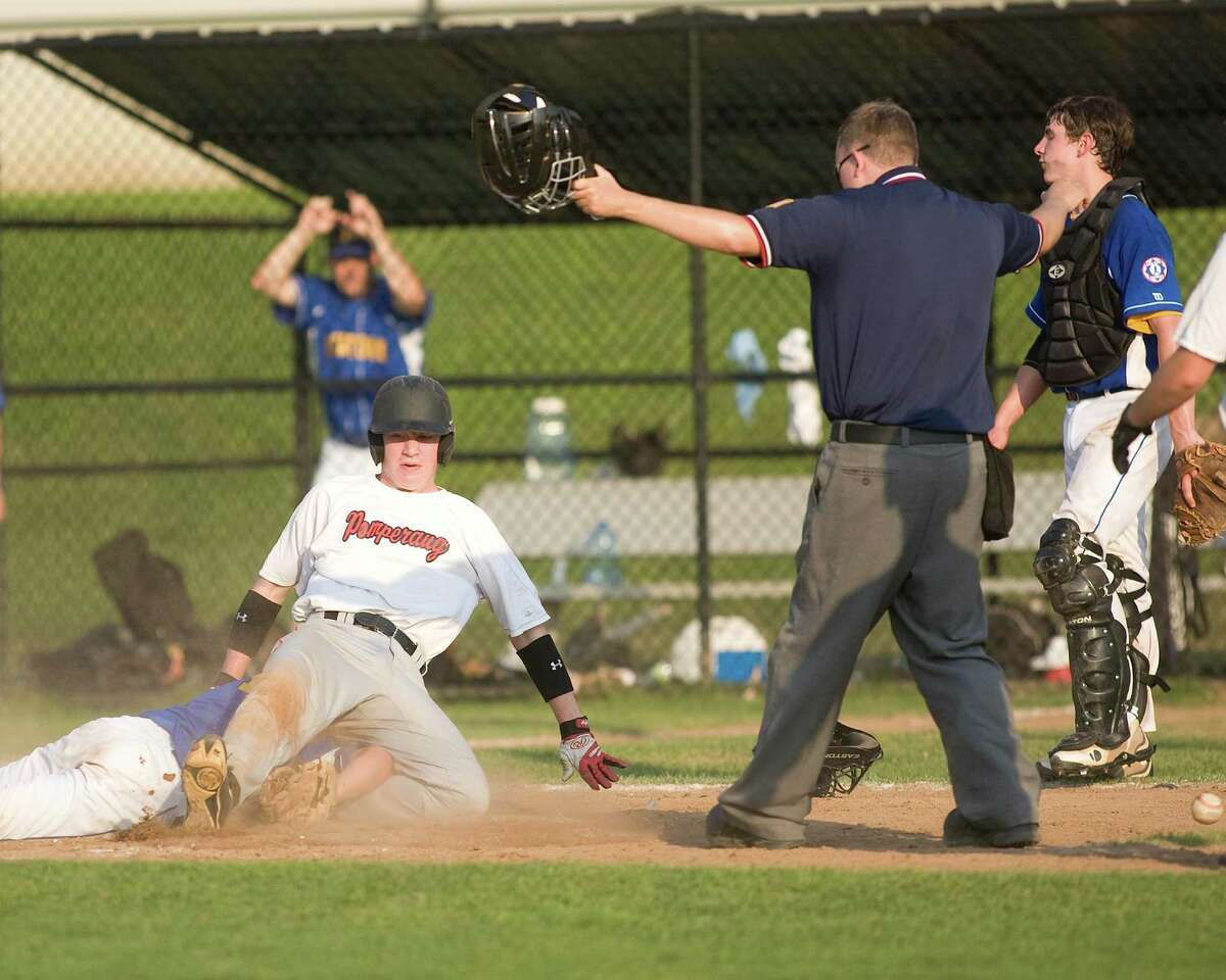 Pomperaug's Michael Kauch scores on a wild pitch as Newtown pitcher Matt Maturo can't handle the throw from catcher Sam Czel in the Jimmy Fund 14-year-old championship game Thursday on the Fairfield Hills campus in Newtown. The ball lies to the right of the umpire.