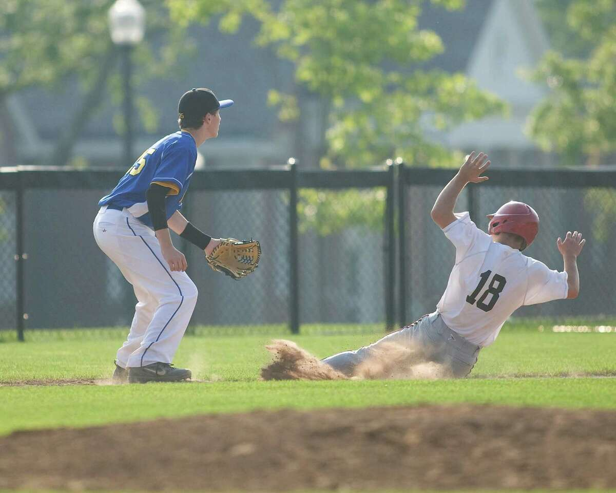 Pomperaug's Dennis Mitchell slides safely into third with a triple as Newtown's Mason Melillo waits for the late throw in the Jimmy Fund 14-year-old championship game Thursday on the Fairfield Hills campus in Newtown.