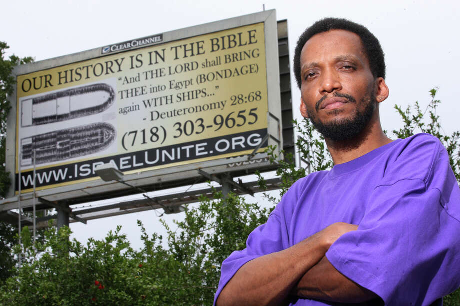 Marataza Ben Israel stand by a billboard his placed near the corner of East Houston and Walters Street, Wednesday, June 20, 2012. He is a member of The Israelites, a faith group that believes African Americans and Latinos are the chosen people spoken of in the bible. Photo: Jerry Lara, San Antonio Express-News / © 2012 San Antonio Express-News