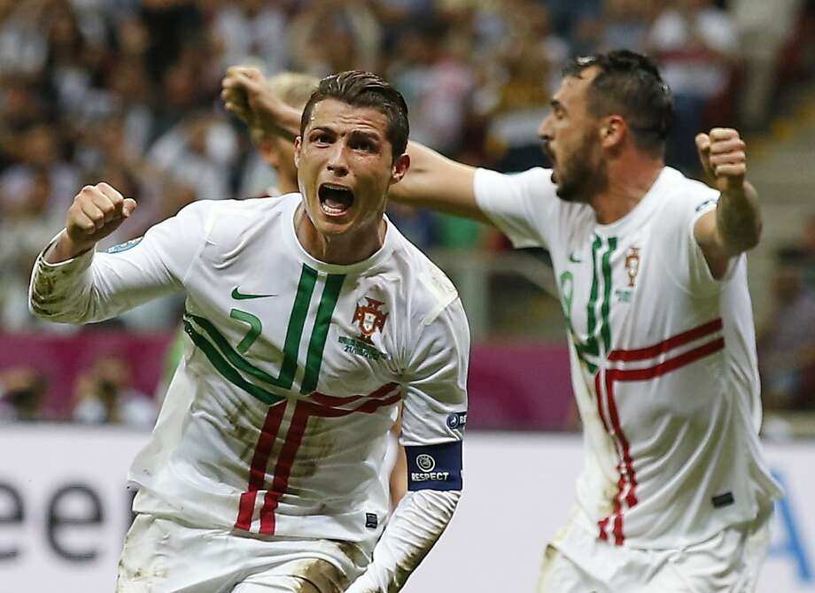 Portugal's Cristiano Ronaldo celebrates after scoring a goal  during the Euro 2012 soccer championship quarterfinal match between Czech Republic and Portugal in Warsaw, Poland, Thursday, June 21, 2012. (AP Photo/Armando Franca) Photo: Armando Franca, Associated Press