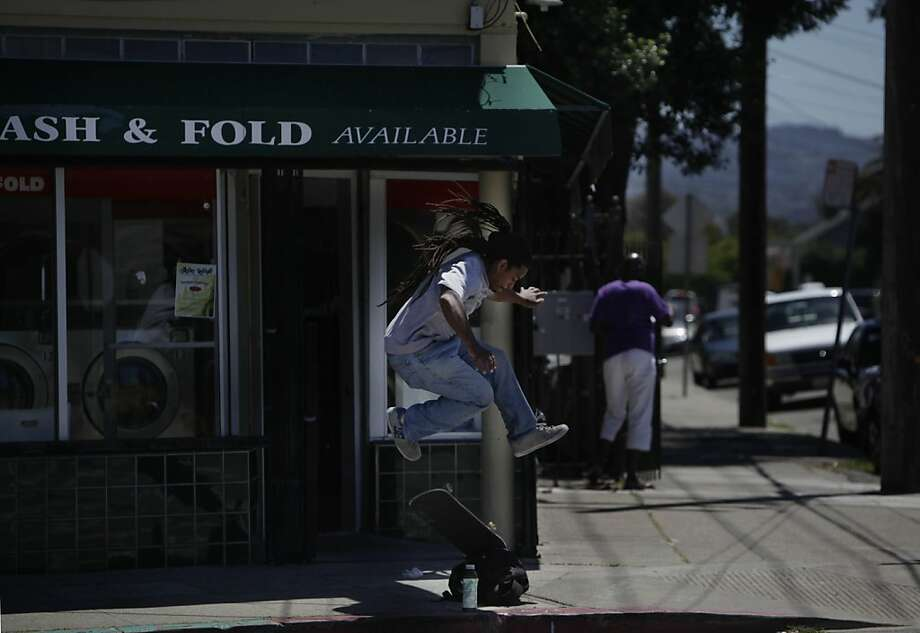 Samuel Carter of Oakland practices his skateboarding as he waits for his laundry to be finished at the corner of Market and 45th Street on Friday, June 8, 2012 in Oakland, Calif. Photo: Lea Suzuki, The Chronicle