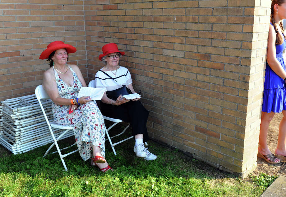 Mom Grace Curry, left, and grandmother Jean Tuomey, sit tucked in a shady corner to watch Shannon Curry graduate, during Fairfield Warde High School's 8th Annual Commencement Exercises in Fairfield, Conn. on Thuursday June 21, 2012. Photo: Christian Abraham / Connecticut Post