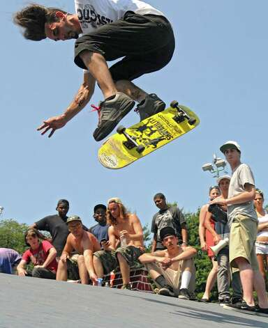 Skateboarders perform tricks during a skateboard contest in Washington Park Thursday, June 21, 2012 in Albany, N.Y. Today is national skateboard day. (Lori Van Buren / Times Union) Photo: Lori Van Buren