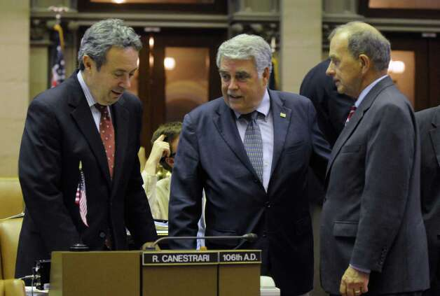 Retiring Assembly Majority Leader Ron Canestrari, left, Assemblyman Jack McEneny and Assemblyman Bob Reilly on the Assembly floor at the Capitol in Albany N.Y.Thursday June 21, 2012. (Michael P. Farrell/Times Union) Photo: Michael P. Farrell / 00018202A