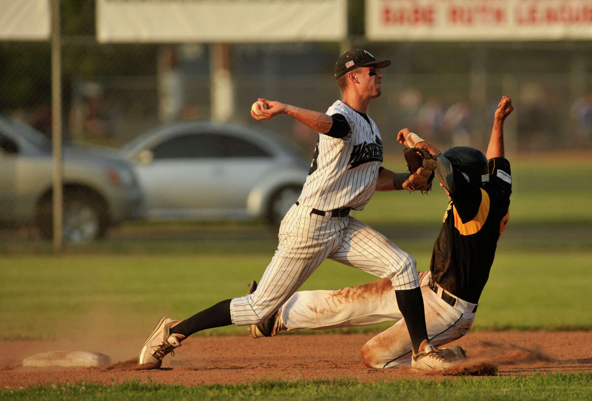 North Adams' Shane O'Connell is forced out at second base as Danbury shortstop Zach Shank turns a double play during their game at Rogers Park in Danbury on Thursday, June 21, 2012. The Westerners won, 11-3.