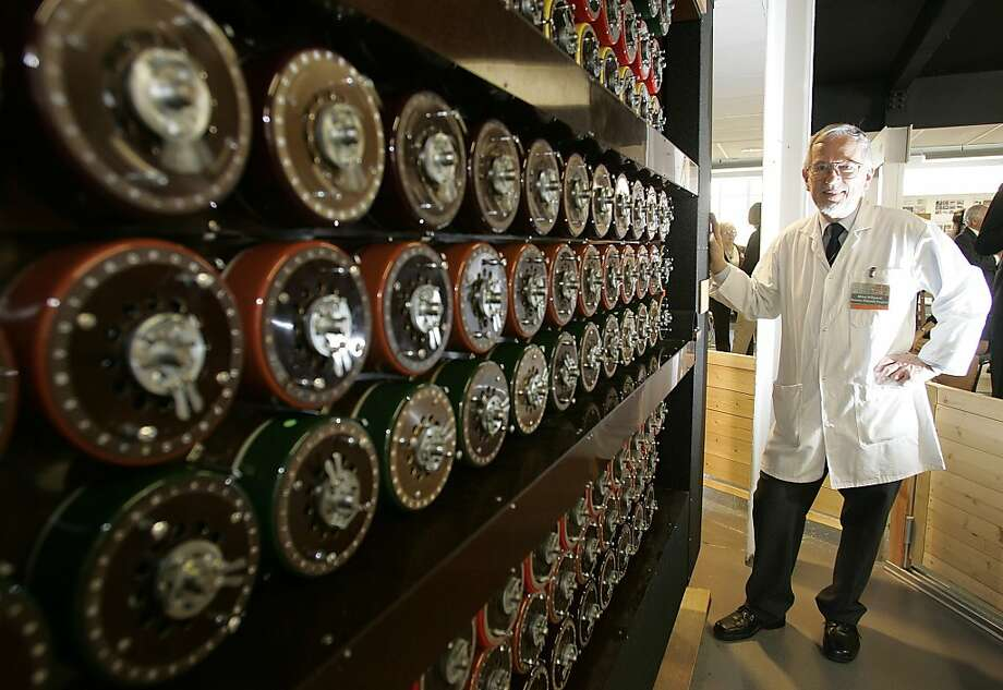 Mike Hillyard, one of the volunteers who rebuilt a replica of the Turing Bombe machine that played a crucial part in cracking the Nazi Enigma Code, stands by the machine at Bletchley Park in Milton Keynes, England, Tuesday, March 24, 2009.  The original machine was destroyed after the war but volunteers rebuilt the replica that received a special Engineering Heritage Award on Tuesday to mark its place in history. (AP Photo/Akira Suemori) Photo: Akira Suemori, ASSOCIATED PRESS