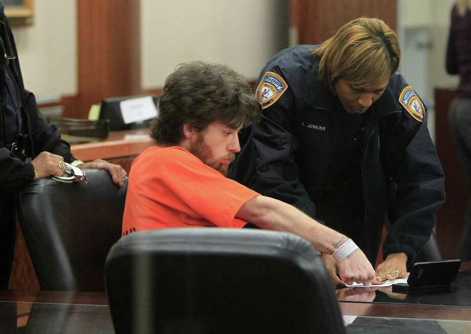 Michael J. Snowden is fingerprinted Thursday after being given a life term. He terrorized two boys in the Freed-Montrose Library in 2010. Photo: Cody Duty / © 2011 Houston Chronicle