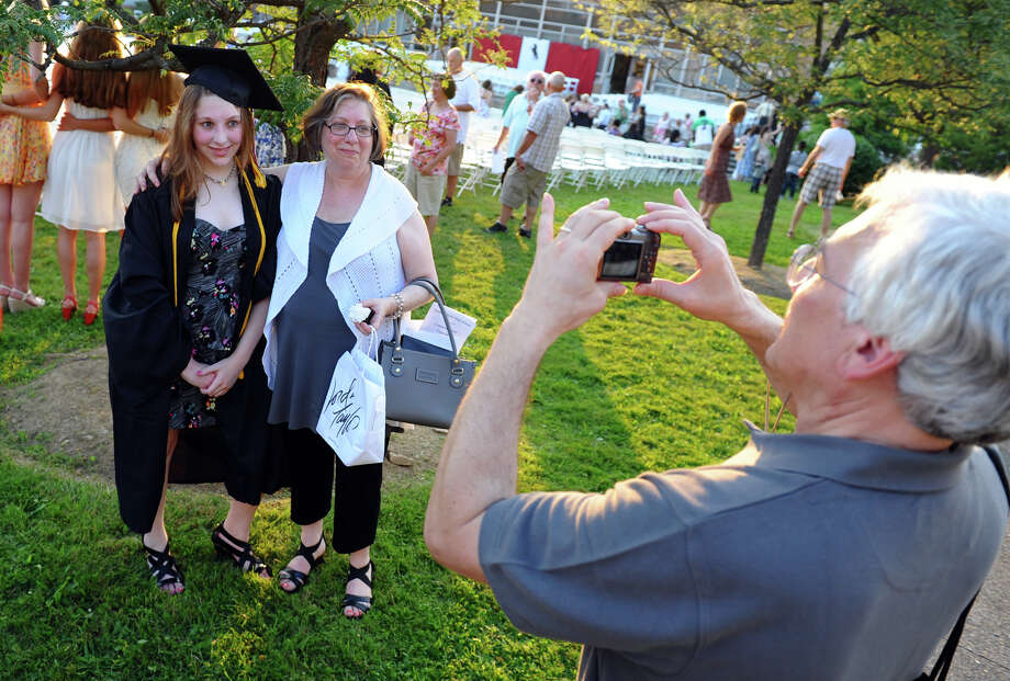 Graduate Morgan Warshaw poses with her mom Sheila as dad Bruce takes a photo, after Fairfield Warde High School's 8th Annual Commencement Exercises in Fairfield, Conn. on Thuursday June 21, 2012. Photo: Christian Abraham / Connecticut Post