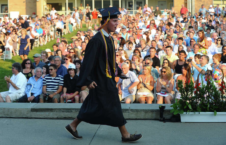 Graduate Tim Wymer shows his excitement, during Fairfield Warde High School's 8th Annual Commencement Exercises in Fairfield, Conn. on Thuursday June 21, 2012. Wymer was the last student to get a diploma. Photo: Christian Abraham / Connecticut Post
