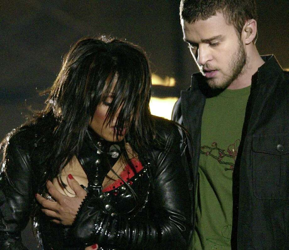 FILE - In this Sunday Feb. 1, 2004 file photo, entertainer Janet Jackson, left, covers her breast after her outfit came undone during the half time performance with Justin Timberlake  at Super Bowl XXXVIII  in Houston. The Supreme Court unanimously threw out fines and sanctions Thursday against broadcasters who violated the Federal Communications Commission policy regulating curse words and nudity on broadcast television. But the justices declined to issue a broad ruling on the constitutionality of the FCC indecency policy. Instead, the court concluded only that broadcasters could not have known in advance that obscenities uttered during awards show programs and a brief display of nudity on an episode of ABC's NYPD Blue could give rise to sanctions. ABC and 45 affiliates were hit with proposed fines totaling nearly $1.24 million. The stepped-up indecency enforcement, including issuing record fines for violations, also was spurred in part by widespread public outrage following Janet Jackson's breast-baring performance during the 2004 Super Bowl halftime show on CBS. (AP Photo/David Phillip, File) Photo: DAVID PHILLIP