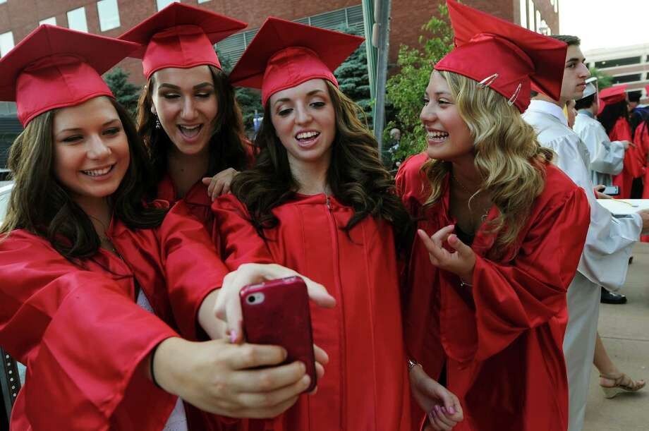 Graduates squeeze in for a photo before the Niskayuna High commencement exercises on Thursday, June 21, 2012, at Proctors Theatre in Schenectady, N.Y. From left are Nicolle Muldowney, 18, Rachel Milstein, 18, Michelle Merry, 18, and Keri Matley, 18. (Cindy Schultz / Times Union) Photo: Cindy Schultz / 00018133A