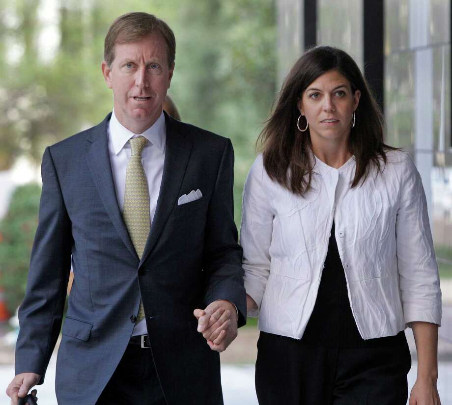 Laura Pendergest-Holt and her defense lawyer, Chris Flood, arrive at court Thursday. Pendergest-Holt, the former chief investment officer for Stanford Financial Group, pleaded guilty to obstructing a government investigation. Photo: Melissa Phillip / © 2012 Houston Chronicle