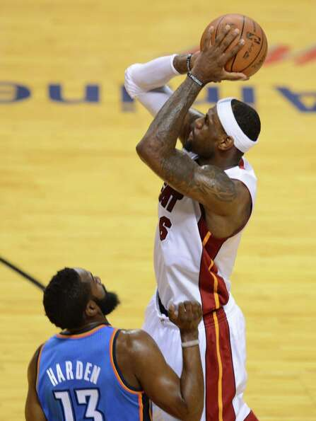 LeBron James shoots before James Harden.