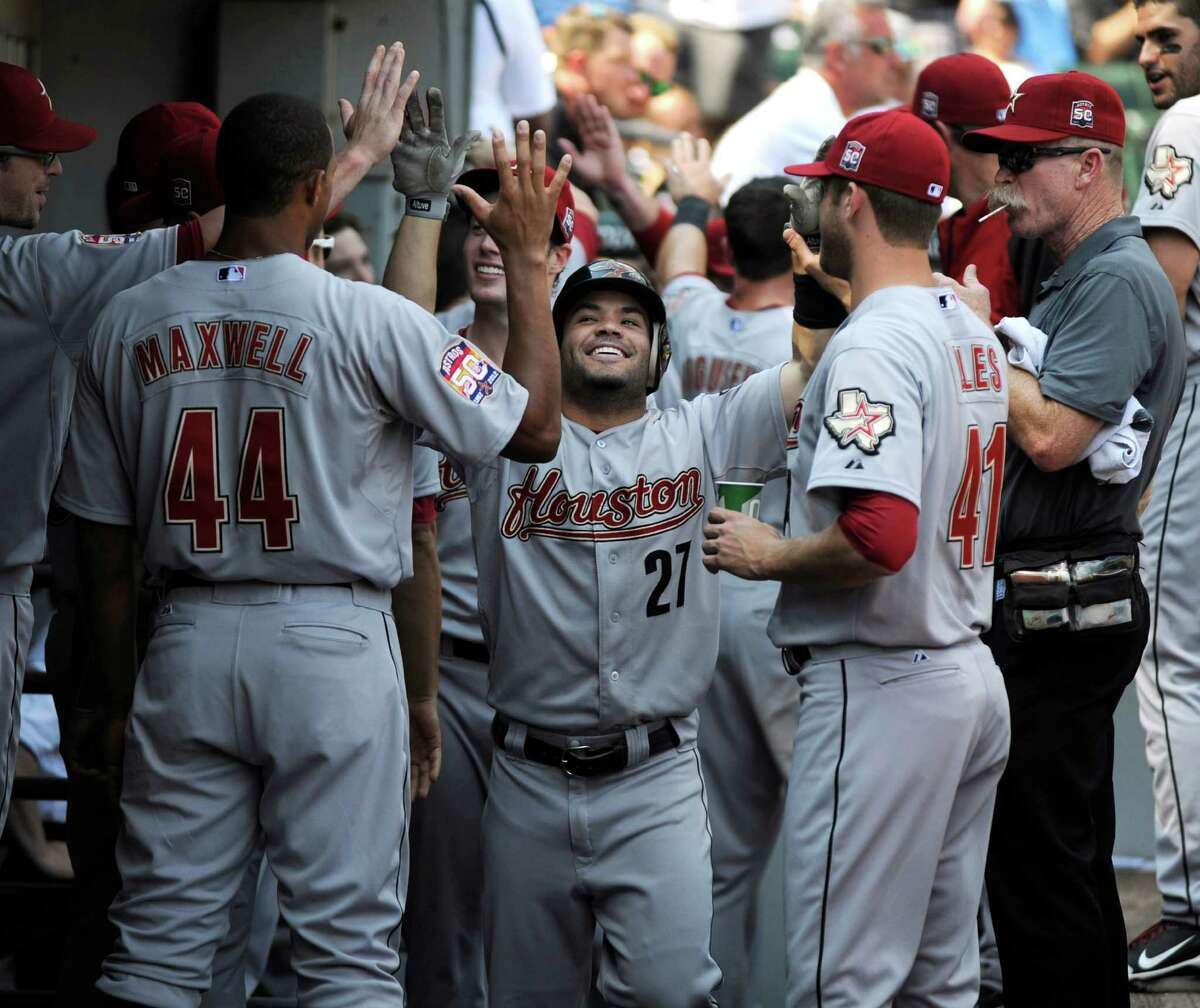 Although towered over by his teammates, Jose Altuve (27) is the center of attention after blasting a two-run homer this month against the White Sox at U.S. Cellular Field in Chicago.