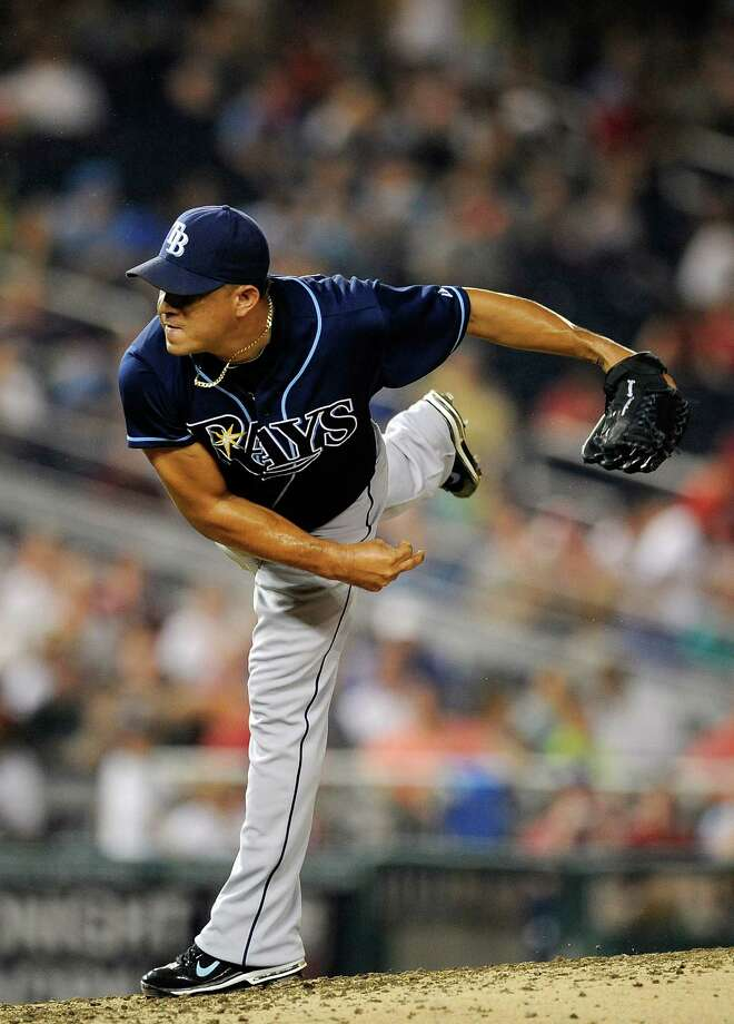 WASHINGTON, DC - JUNE 21:  Joel Peralta #62 of the Tampa Bay Rays throughs a pitch against the Washington Nationals at Nationals Park on June 21, 2012 in Washington, DC.  (Photo by Patrick McDermott/Getty Images) Photo: Patrick McDermott