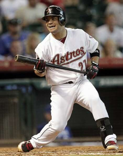 Jose Altuve reacts after not being able to check his swing on called strike three. (Bob Levey / Gett