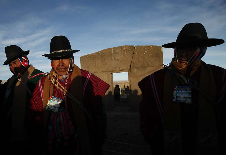 Aymara indigenous men attend a new years' ritual at the ruins from the ancient civilization of Tiwanaku, on the highlands in Tiwanaku, Bolivia, Thursday, June 21, 2012. The Aymara celebrate the year 5,520 as well as the southern hemisphere's winter solstice, marking the start of a new agricultural cycle. (AP Photo/Juan Karita) Photo: Juan Karita, Associated Press