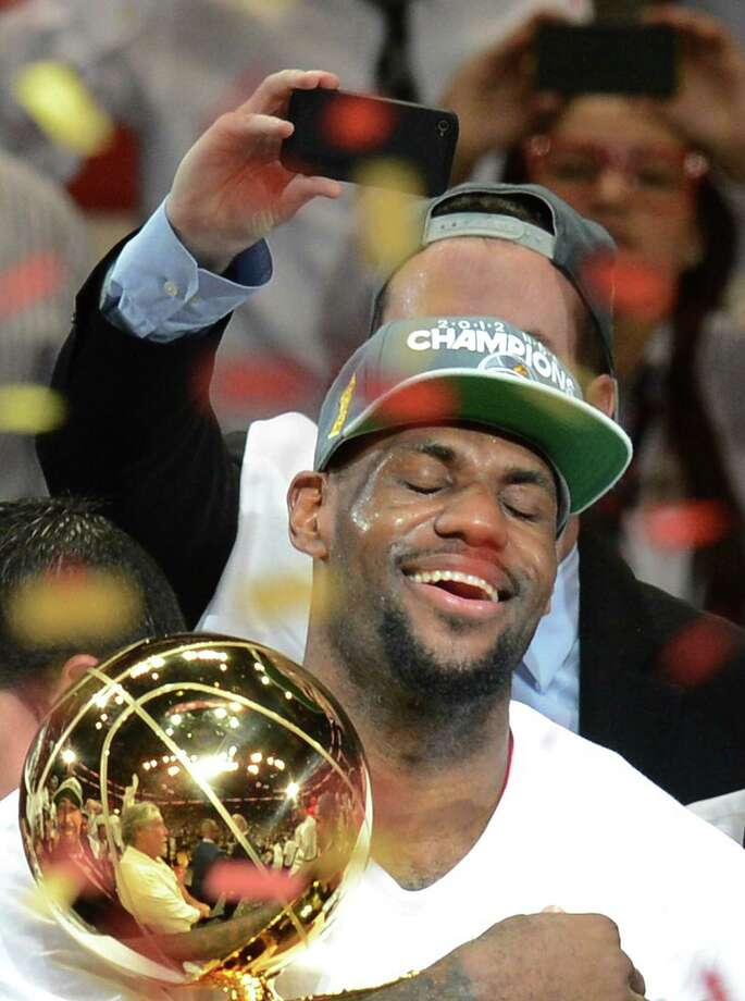 Crown the King (finally)The only things LeBron James didn't seem to win in 2012 were Powerball and the presidential election. NBA MVP. NBA Finals MVP. Olympic champion. And, at long last, he got his hands on the NBA championship trophy, when the Miami Heat beat the Oklahoma City Thunder in five games. Photo: DON EMMERT, AFP/Getty Images / AFP