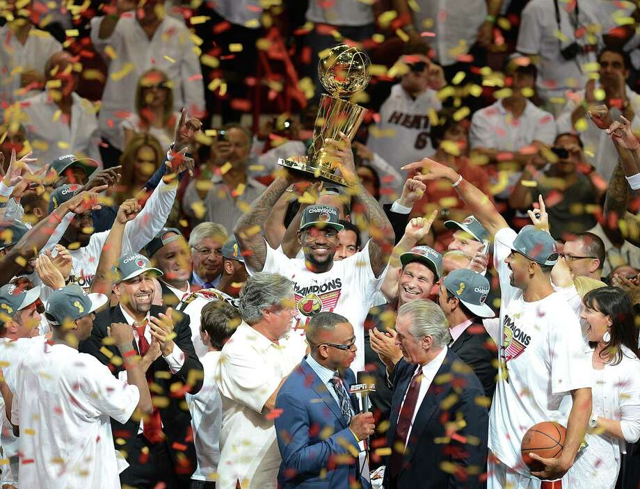 Game 5: Heat 121, Thunder 106 ... NBA Finals MVP LeBron James of the Miami Heat holds the championship trophy. Photo: DON EMMERT, AFP/Getty Images / AFP