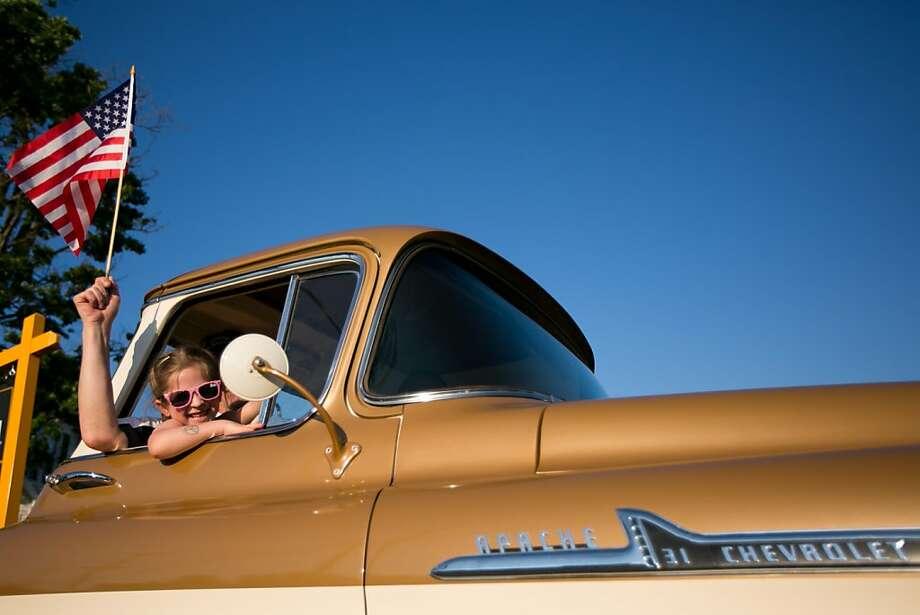 Parade members make their way through Flushing in a vintage Chevrolet pickup truck. Wednesday June 20, 2012. (AP Photo/Brett Carlsen, Flint Journal) Photo: Brett Carlsen | MLive.com, Associated Press