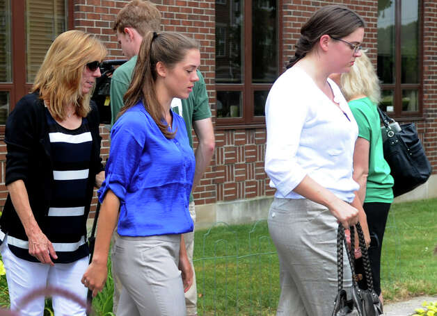 Brianna McEwan, center, leaves the Norwalk Courthouse after a continuance was granted in her case on Friday, June 22, 2012. McEwan is facing negligent homicide charges in the death of Norwalk jogger Kenneth Dorsey this spring. All cases were continued at the Norwalk Courthouse on Friday due to a power outage in the building. Photo: Lindsay Niegelberg / Stamford Advocate