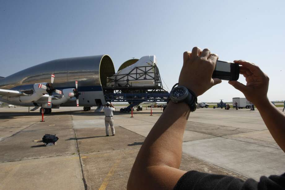 The   nose section of the full fuselage trainer cockpit used to train   astronauts for space shuttle flights is moved into the NASA Super Guppy cargo plane Friday morning at Ellington International  Airport in Houston. It will be moved to the Museum of Flight in Seattle, where it will go  on display. Photo: Johnny Hanson, Houston Chronicle