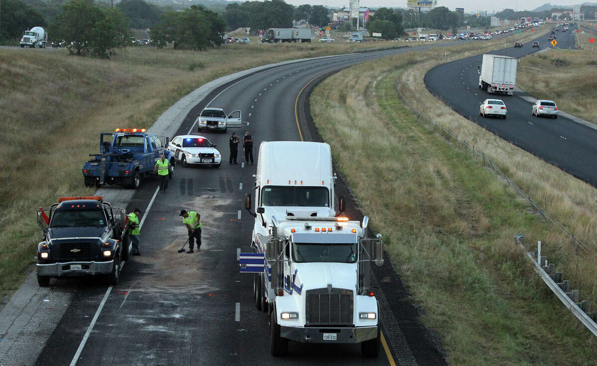 Crews clean up the site of a fatal 18-wheeler accident that took place about 11:00 p.m. Thursday night on IH-10 west near the Ralph Fair road exit. Traffic was diverted in the area off of the interstate until about 7:00 a.m. Friday morning June 22, 2012. John Davenport/San Antonio Express-News