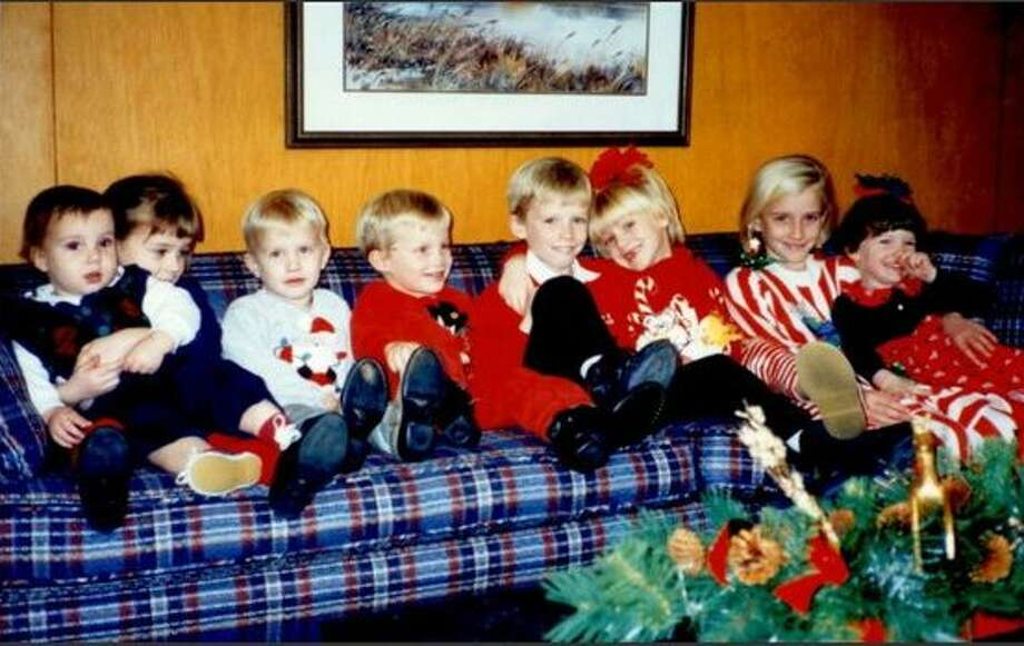 The Mitchell Cousins: Drew, Morgan, Brian, Matt, Will, Cara, Erin, and Molly at Christmas in 1996 at the home of their grandparents grandparent's house Yeola and Melvin Mitchell. Photo: Picasa, COURTESY