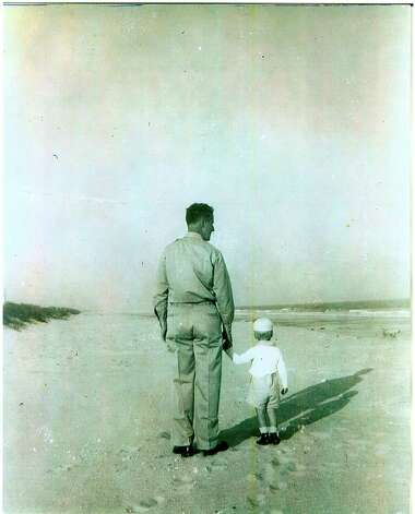 Albert Halff walks on the beach in Myrtle Beach, S.C. where he was stationed during World War II with his son Henry, about 2. Photo: COURTESY